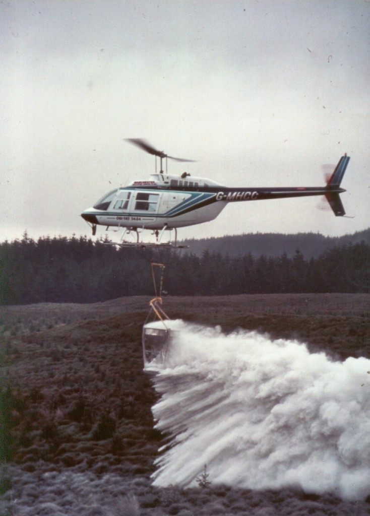 lime spreading for the Macauley Land Use Research Institute above Loch Lomond (May 1990) by M. D. Air Services